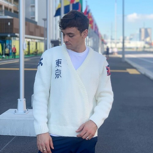 Olympic champion Tom Daley showcases Team GB Ready-Made cardigan at Tokyo 2020 to raise charity